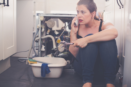 Woman is calling a plumber